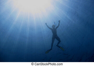 snorkel with sun rays - snorkel and dive in blue sea with...