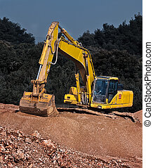 industrial gravel and excavator - excavator positioned on...