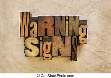 Warning Signs - The words Warning Signs written in vintage...