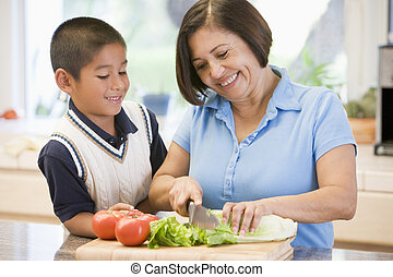 Grandmother And Grandson Preparing meal,mealtime Together