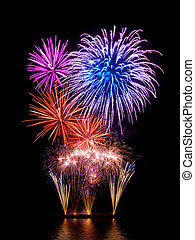 Magnificent fireworks display with happy colors on black...