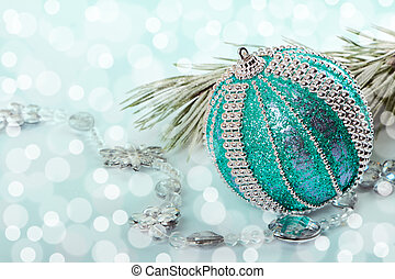 Christmas bauble with pine branch on abstract background