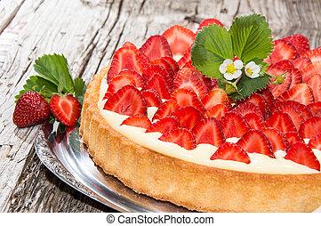 Fresh baked Strawberry Cake on wooden background