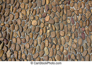 Old rounded cobbles - Close-up part of an antique road with...