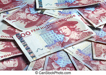 Swedish paper currency laying randomly - A bunch of Swedish...
