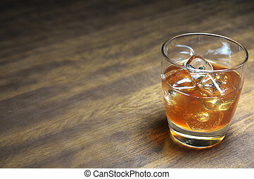 Bourbon on the Rocks - Bourbon on the rocks on wooden table...