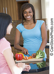 Women Laughing With Friend While Preparing meal,mealtime