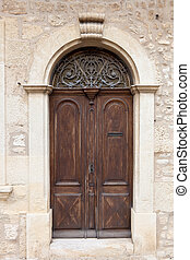 Old wooden door - Brown aged rounded door of a an old...