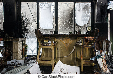 Fire damaged interior details in summer house after blaze