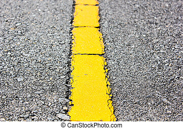 surface of asphalt road yellow line close up background