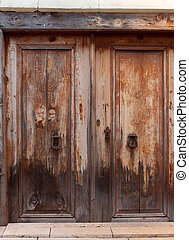 Old front door - Ancient wheathered entrance door, built of...