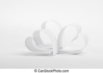 Valentines day card with paper white hearts on white