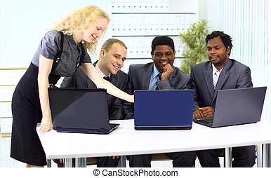 multi ethnic business team working on laptop