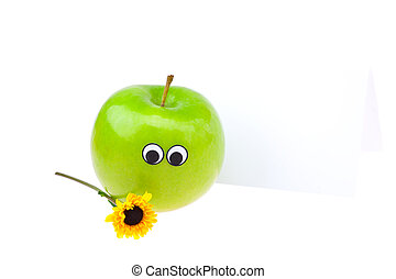apples with eyes and faces and a flower isolated on white