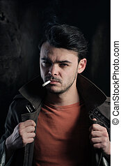 Handsome man smoking a cigarette - Portrait of a good...