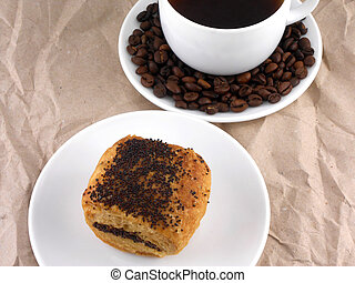 Coffee and coffee beans on white plate with sweet cake