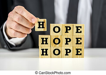 Hope - Putting together wooden cubes with letters on them...