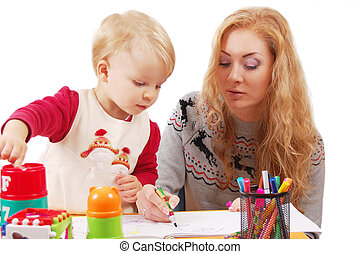 Little daughter learning to draw with her mother