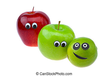 lime and apple with eyes and faces isolated on white