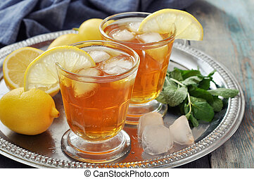 Ice tea with lemon - Ice tea in glass with lemon and mint on...