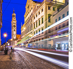 Augsburg, Germany at Rathausplatz as a street car passes by.