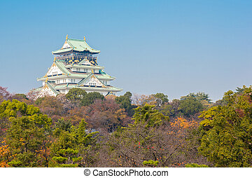 Osaka castle Japan - Osaka castle with autumn garden in...