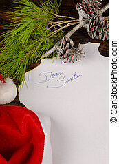 Christmas wish list surrounded by seasonal ornaments