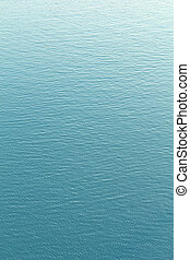Blue water background with ripples