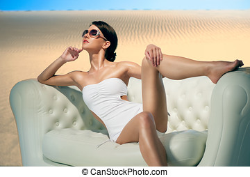 Sexy girl in sofa - Sexy girl in dress lying on sofa on...