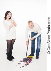 Sweeping petals - Man sweeping petals