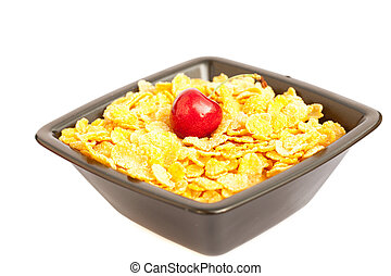 cherry in a bowl with cornflakes isolated on white