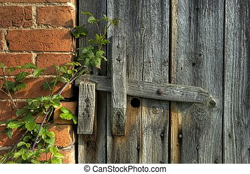 Wooden latch - Old barn door with wooden latch,...