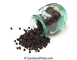 black pepper in glass bottle on white background