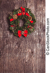 Christmas wreath with decorations on the rustic wooden...