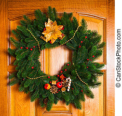 Christmas wreath with red sock on the door