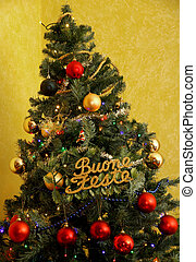 Christmas tree with written happy holidays - decorated...