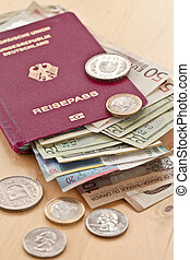 German passport and different currencies in bills and coins