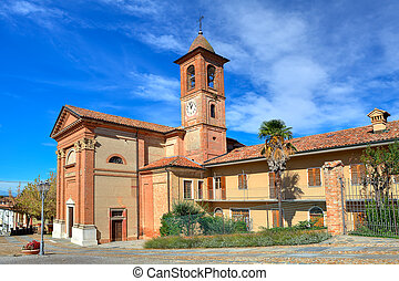 Church in small italian town. - Old red brick catholic...
