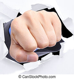 Businessman punch through white paper for slove every...