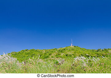 Communication Tower with Antenna on mountain against the...