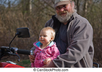 Grandpa and Granddaughter on Motorcycle - Rough rugged...