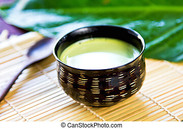 Green tea latte - Green tea or Matcha with milk in a wood...