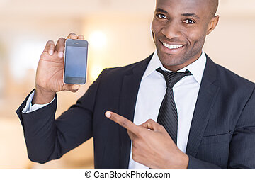 Businessman with mobile phone. - Cheerful young African man...