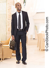 Confident businessman. - Full length of cheerful young...
