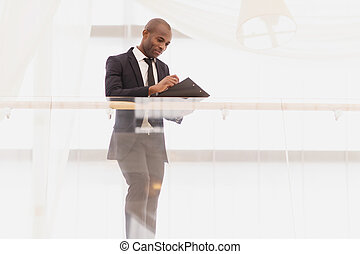 Businessman with note pad. Low Angle view of confident young...
