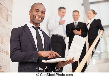 Confident businessman Cheerful young black man in formalwear...