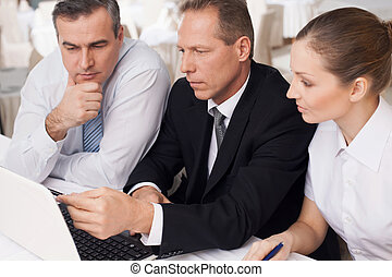 Business people at work Three confident business people in...