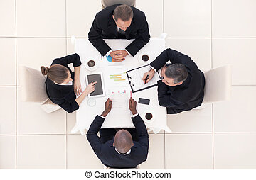 Business meeting. Top view of four business people in...