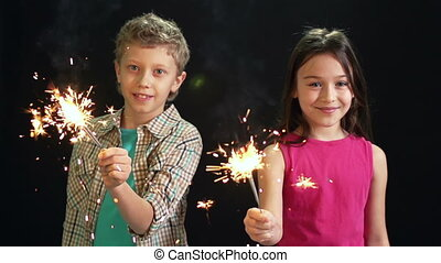 Merry Friends - Cheerful friends holding sparkling lights on...
