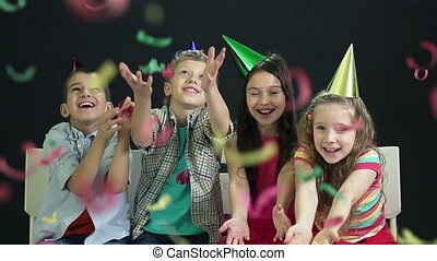 At Party - Slow-motion of children having fun at party...